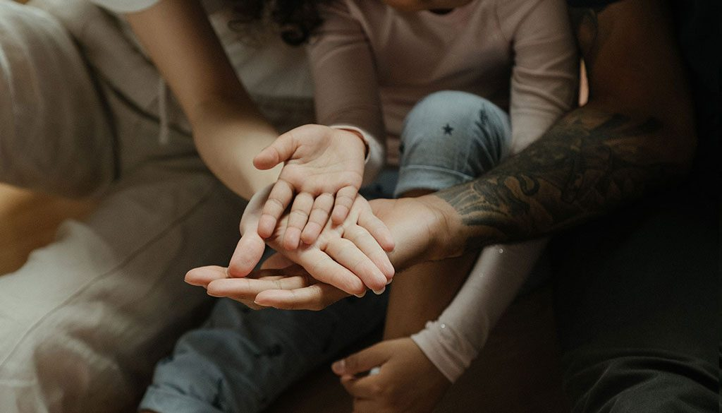family-hands-covid