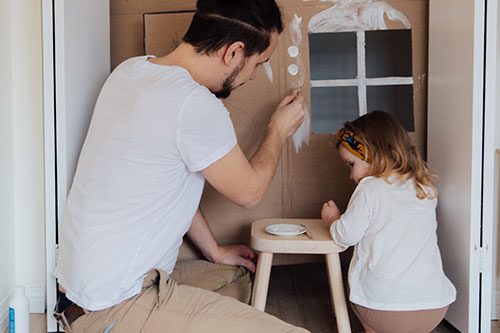 man-painting-with-child